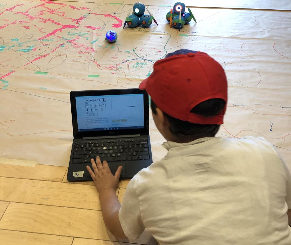 Camper coding sequences to create art with markers, paint and the robots, Dash and Sphero.